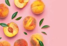 Summer fruit background. Flat lay composition with peaches. Ripe